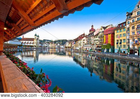 Chappel Bridge Historic Wooden Landmark In Luzern And Town Riverfront View, Town In Central Switzerl