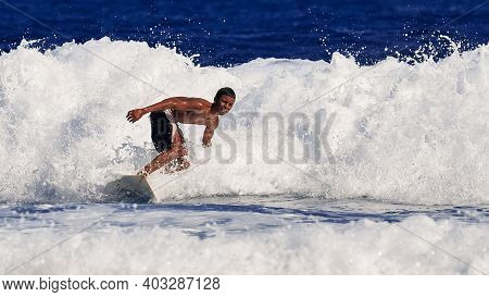 Surfer School. A Young Guy Learning To Stand On A Surfboard. Surfer On The Wave. Beautiful Ocean Wav