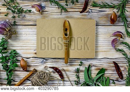 Culinary Book For Writing Background. Notebook For Writing Culinary Recipes In A Frame Of Sprigs Of
