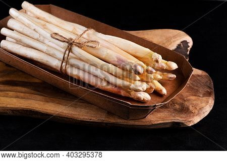 Healthy Vegetables.white Asparagus On A Kitchen Wooden Board .raw Organic White Asparagus.organic Wh