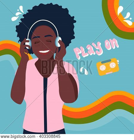 Young Afro American Woman In Headphones Listening To Lovely Music And Smiling. Melomaniac, Fan. Rain
