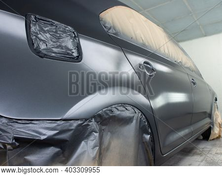 Car At The Stage Of Painting In The Workshop. Repair Process Of Car Paintwork. The Process Of Painti