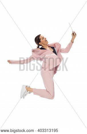Tablet. Happy Young Woman Dancing In Casual Clothes Or Suit, Remaking Legendary Moves And Dances Of