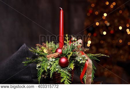 Composition With A Bouquet Of Flowers And Burning Candle On Dark Background, Festive Evening Atmosph