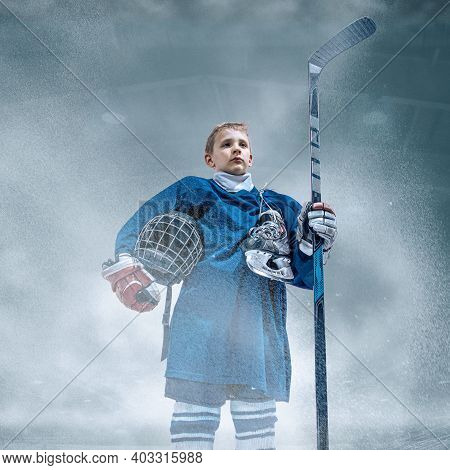 Leader. Little Hockey Player With The Stick On Ice Court And Smoke Background. Sportsboy Wearing Equ