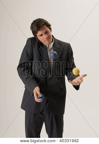 Juggling While Chatting On Mobile Phone
