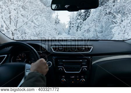 Man Drives A Car On Snow Winter Road.