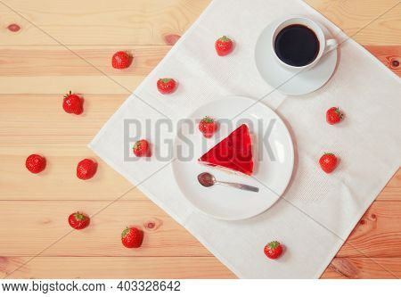 Piece Of Sweet Strawberry Cake, Cup Of Coffee And Fresh Ripe Strawberry Near On Wooden Table. Top Vi