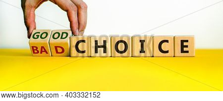 Good Or Bad Choice Symbol. Businessman Turns Wooden Cubes And Changes Words 'bad Choice' To 'good Ch
