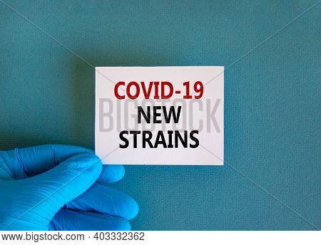 Covid-19 New Strains Symbol. Hand In Blue Glove With White Card. Concept Words 'covid-19 New Strains