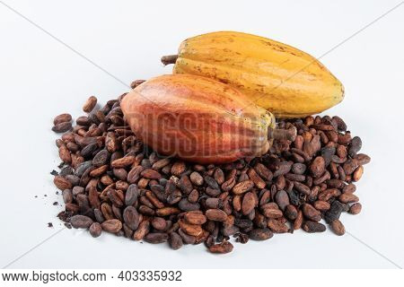 Cocoa Fruit Over Raw Cocoa Beans On White Background