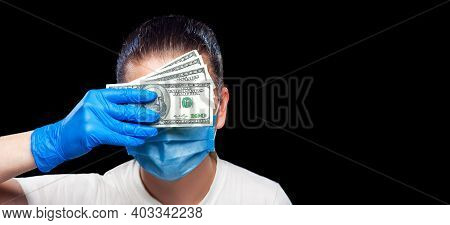 Portrait Of A Doctor In A Protective Mask And Sterile Gloves Holding A Bribe Covering His Corrupt Fa
