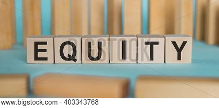 Equity. Word Written On Wooden Blocks On Light Blue Background.