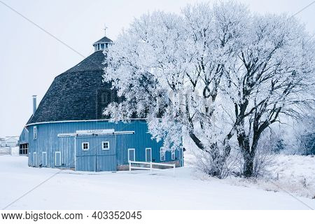 Chisago City, Minnesota - January 9, 2021: The Ca Moody Blue Round Barn On Moody Lake In Chisago Cit
