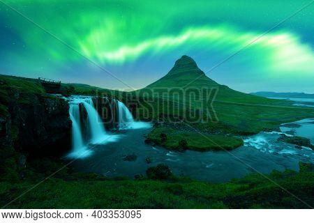 Aurora borealis Northern lights over Kirkjufellsfoss waterfall. Amazing night scene near Kirkjufell volkano, Iceland. Landscape photography. Courtesy of NASA. Photo collage