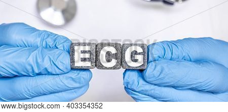 Ecg Electrocardiography Electrocardiogram - Word From Stone Blocks With Letters Holding By A Doctor'