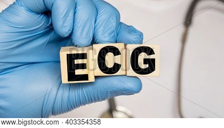 Ecg Electrocardiography Electrocardiogram - Word From Wooden Blocks With Letters Holding By A Doctor