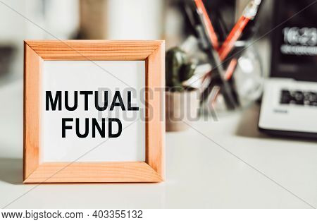 Wooden Frame With Office Background With The Text Mutual Fund