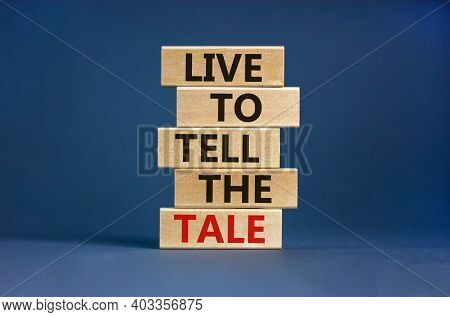 Live To Tell The Tale Symbol. Wooden Blocks With Words 'live To Tell The Tale' On Beautiful Grey Bac