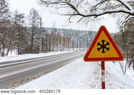Winter Traffic Warning Sign Shows Danger Of Ice And Snow At Street, Highway Or Road. Winter Driving.