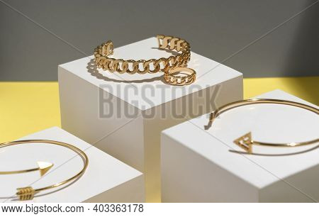 Close Up On Chain Shape Bracelet And Ring With Arrow Shape Bracelet On White Display