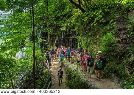 Plitvicka Jezera, Croatia, July 2019 Tourists Taking Pictures And Making Selfies At Waterfalls In Pl