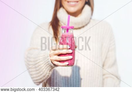 Smiling Woman In Woollen Sweater Holding Bottle With Pink Homemade Detox Blueberry And Raspberry Smo