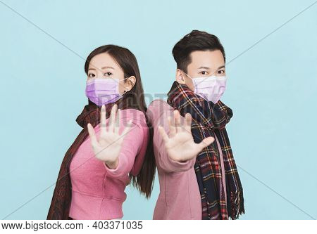 Young Couple Wearing  Protective Face Mask And Showing No Gesture . Flu And Coronavirus Prevention