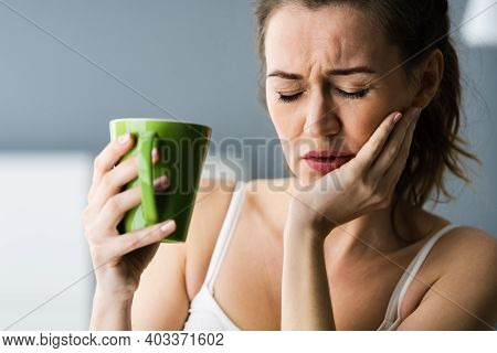 Tooth Ache And Pain Drinking Hot Drink