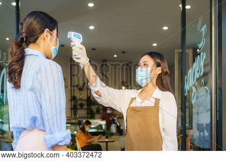 Asian Woman Cafe Employee Take Temperature Asian Woman With Face Mask Before Go To Restaurant Or Cof