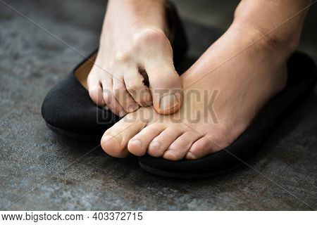 Woman Bare Feet Close Up With Smelly Boot