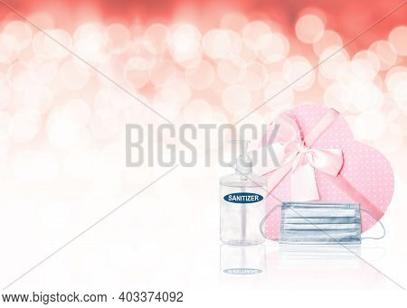 Valentine's Day Concept During Covid-19 Pandemic With Heart-shaped Pink Gift Box, Face Mask, Hand Sa