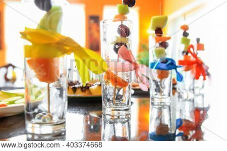 Colorful desert glasses in a row with selective focus