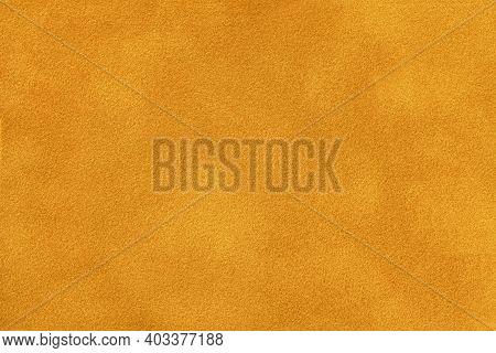Dark Orange Matte Background Of Suede Fabric, Closeup. Velvet Texture Of Seamless Golden Textile, Ma