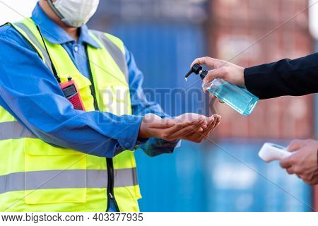 Worker Wash Your Hands With Gel And Scanning Fever Temperature With Digital Thermometer To Industry