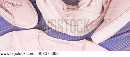 Pink Leather Shoes, Sweater And Shawl For Woman Lying On Old Purple Boards