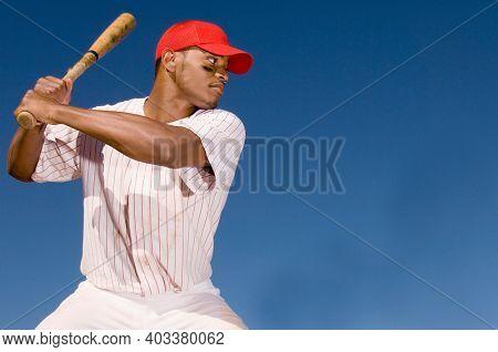 Photo of Baseball Batter hitting the Ball