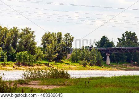 Automotive Concrete And Metal Bridge Over A River