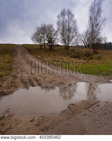 A Muddy Puddle And A Dirt Road At A Moor. Picture From Revingehed, Scania County, Sweden