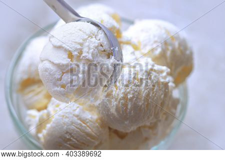 Balls Of Vanilla Ice Cream In Glass Cup