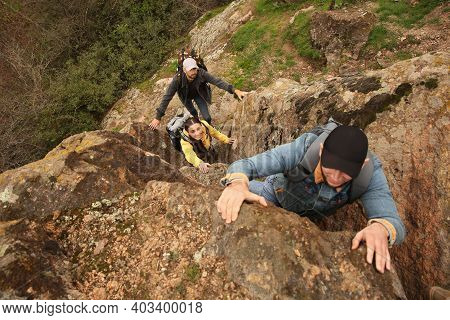 Group Of Hikers With Backpacks Climbing Up Mountains, Above View