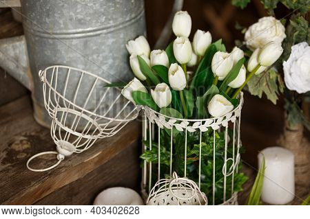 Rustic Interior Of Spring Yard. Spring Greenery And Flowers, A Pot With Green Plants. Beautifully De