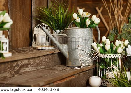 Spring Greenery And Flowers, A Pot With Green Plants. Beautifully Decorated Farmhouse Look. Rustic I