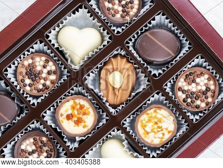 Different Chocolate Pralines. Box Of Belgian Pralines Of Different Shapes. Assortment Of Fine Belgiu