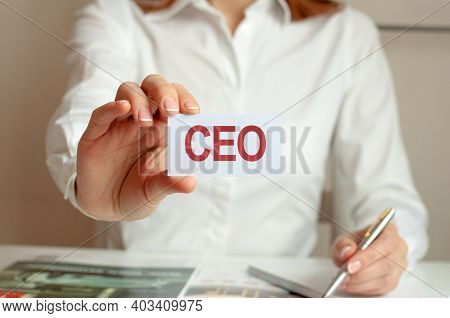 Motivational Words: Ceo. A Woman In A White Shirt Holds A Piece Of Paper With The Text: Ceo. Busines