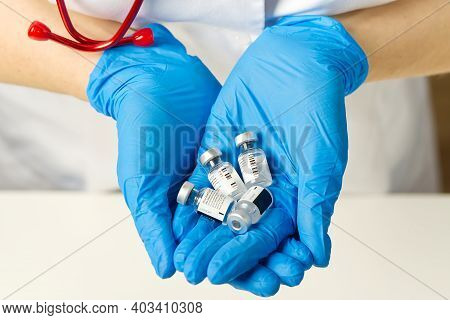 Estonia, Tallinn, 09.01.2021 Doctor Holds In Hands Small Ampoules Of Covid-19 Vaccine By Pfizer And