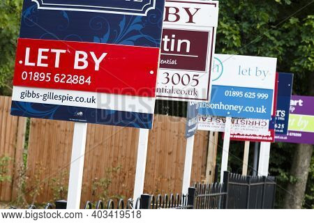 London, Uk - August 19, 2013. Estate Agent Let By Signs Advertise Property In A Suburb Of London