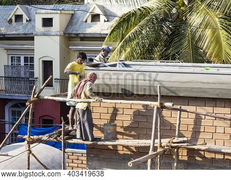 Bangalore, India - January 31, 2014. Construction Workers Build An Apartment Block In Bengaluru, For
