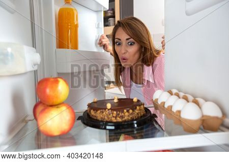 Oooooo, That Looks Tasty, Hungry Young Woman Setting Her Eyes On The Sweets