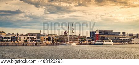 Iconic Port Adelaide Lighthouse With Tourist Boat Viewed Across Port River At Sunset, South Australi